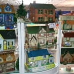 """Over 70 vintage dollhouses circa 1920-present, including the 1949 """"Disney House"""" and the 1924 Tootsie Roll house."""